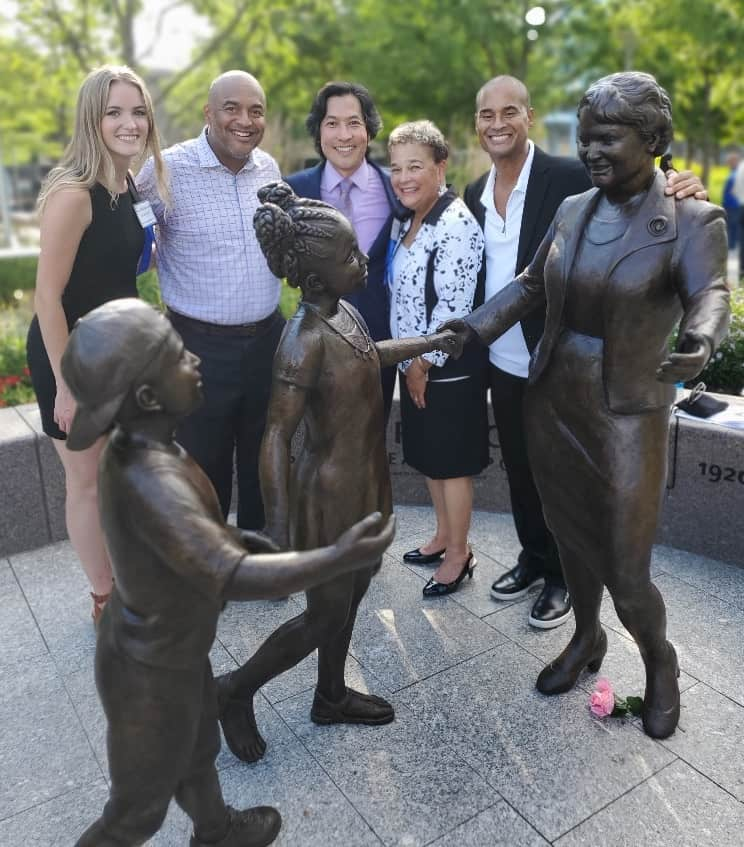 Anderson family with Marian Spencer statue